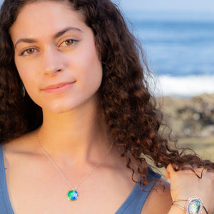 model at beach with ocean colors silver enamel necklace seaside harmony