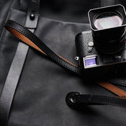 black red-brown leather camera shoulder strap