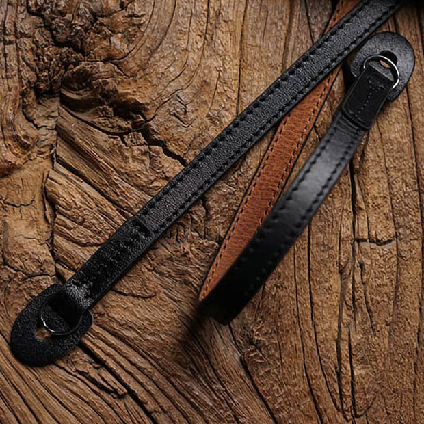 black red-brown leather camera strap