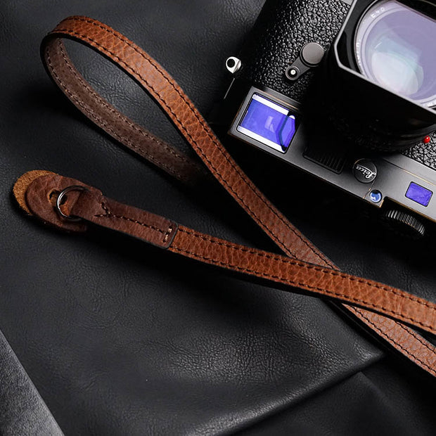 red-brown leather camera shoulder strap