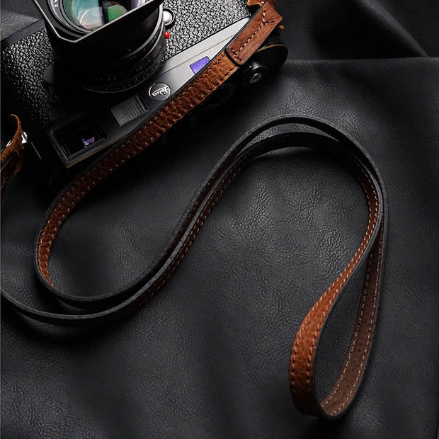 red brown leather camera shoulder strap