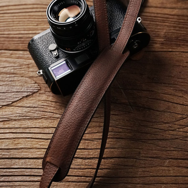 red brown leather camera strap