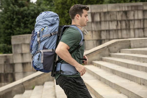 How can I carry a heavy backpack more easily?