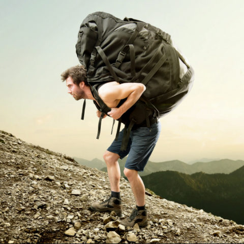 What is the hazard of carrying a heavy bag for a long time?