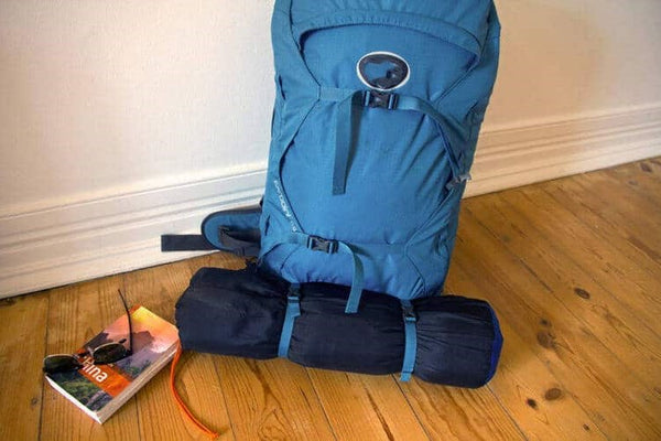 How to pack a tent into a backpack