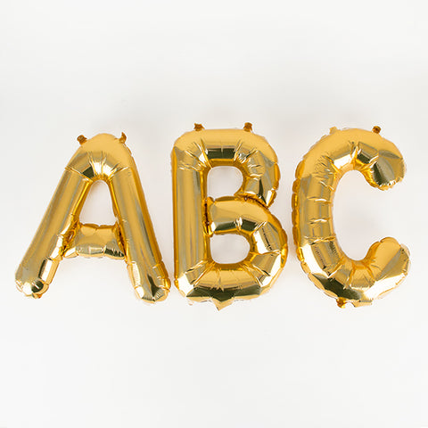 Small gold letter foil balloon
