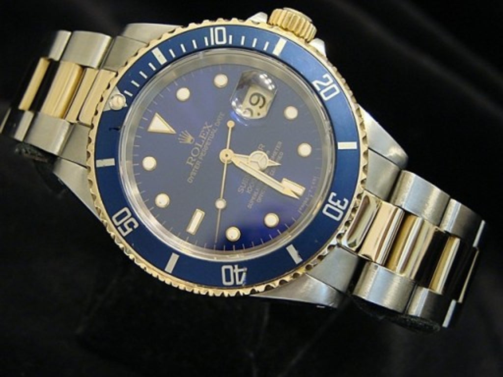 PRE OWNED MENS ROLEX TWO-TONE SUBMARINER WITH A BLUE DIAL 16613