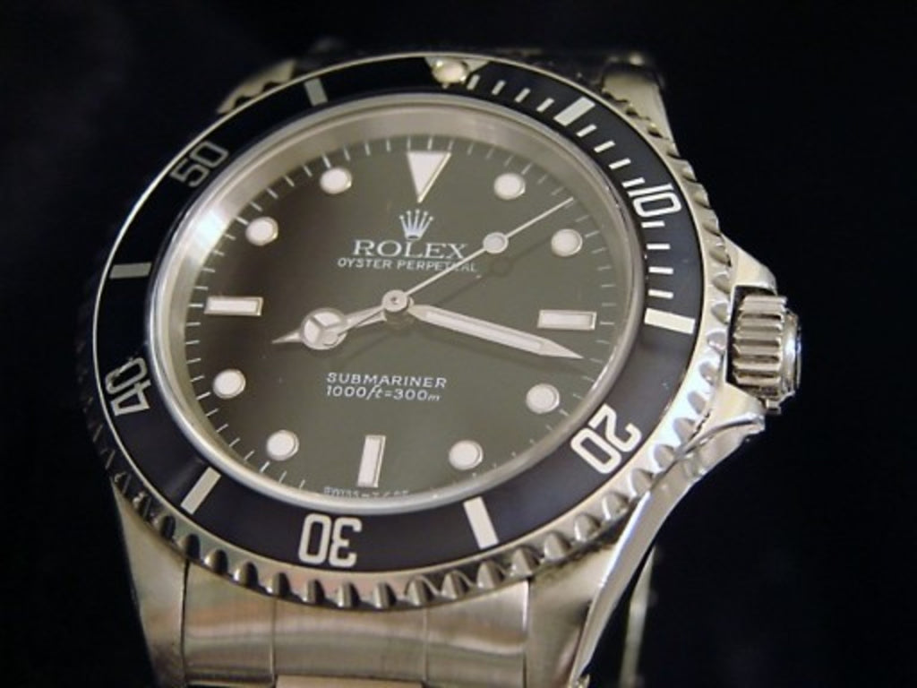 PRE OWNED MENS ROLEX STAINLESS STEEL SUBMARINER WITH A BLACK DIAL 14060