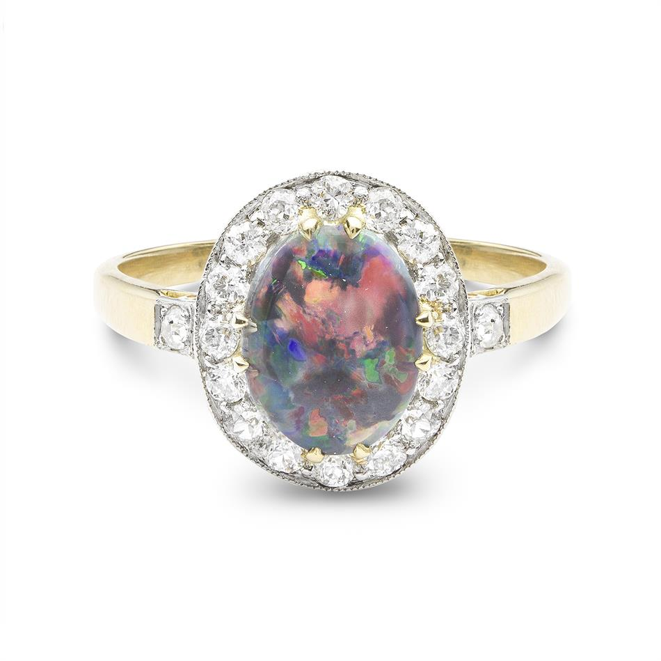 A 1920\'s black opal and diamond cluster ring