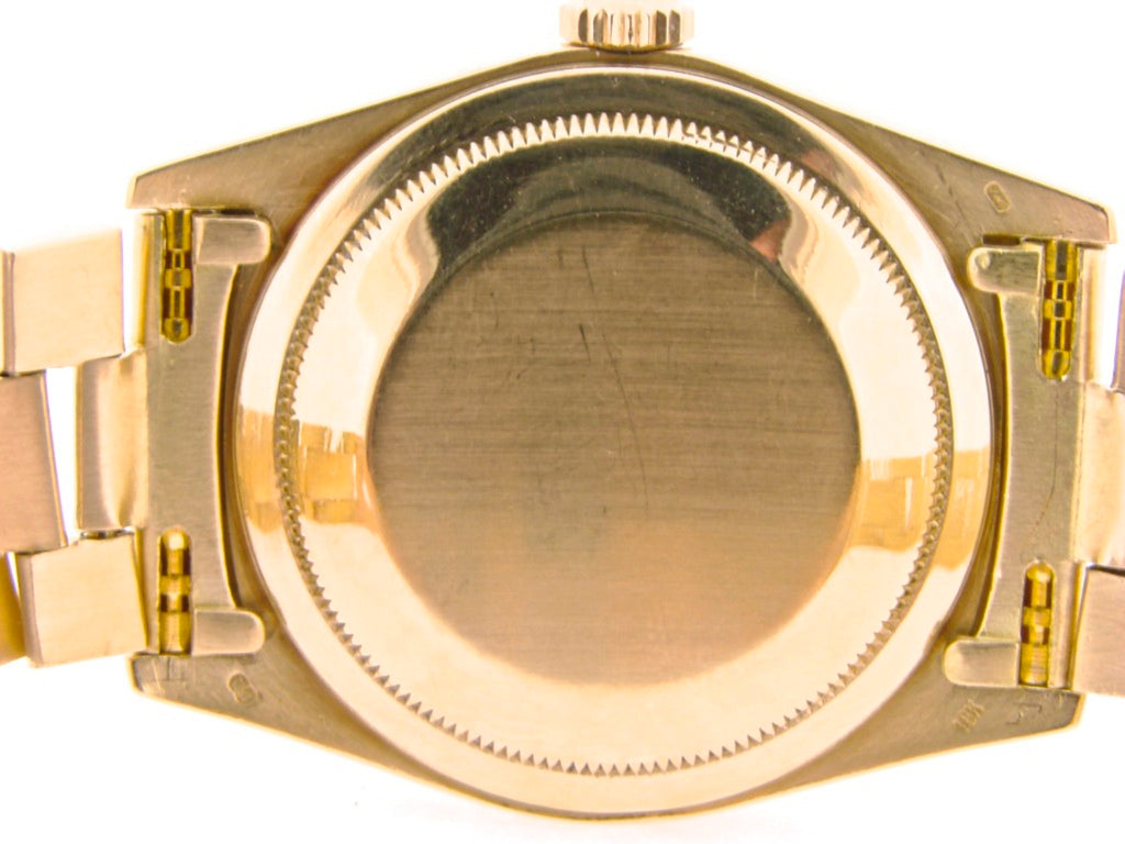 PRE OWNED MENS ROLEX YELLOW GOLD DAY-DATE WITH A GOLD/CHAMPAGNE DIAL 18038