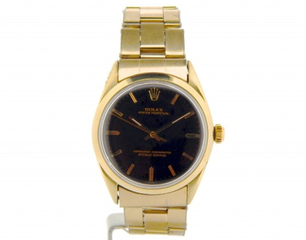 PRE OWNED MENS ROLEX GOLD SHELL OYSTER PERPETUAL WITH A BLACK DIAL 1024