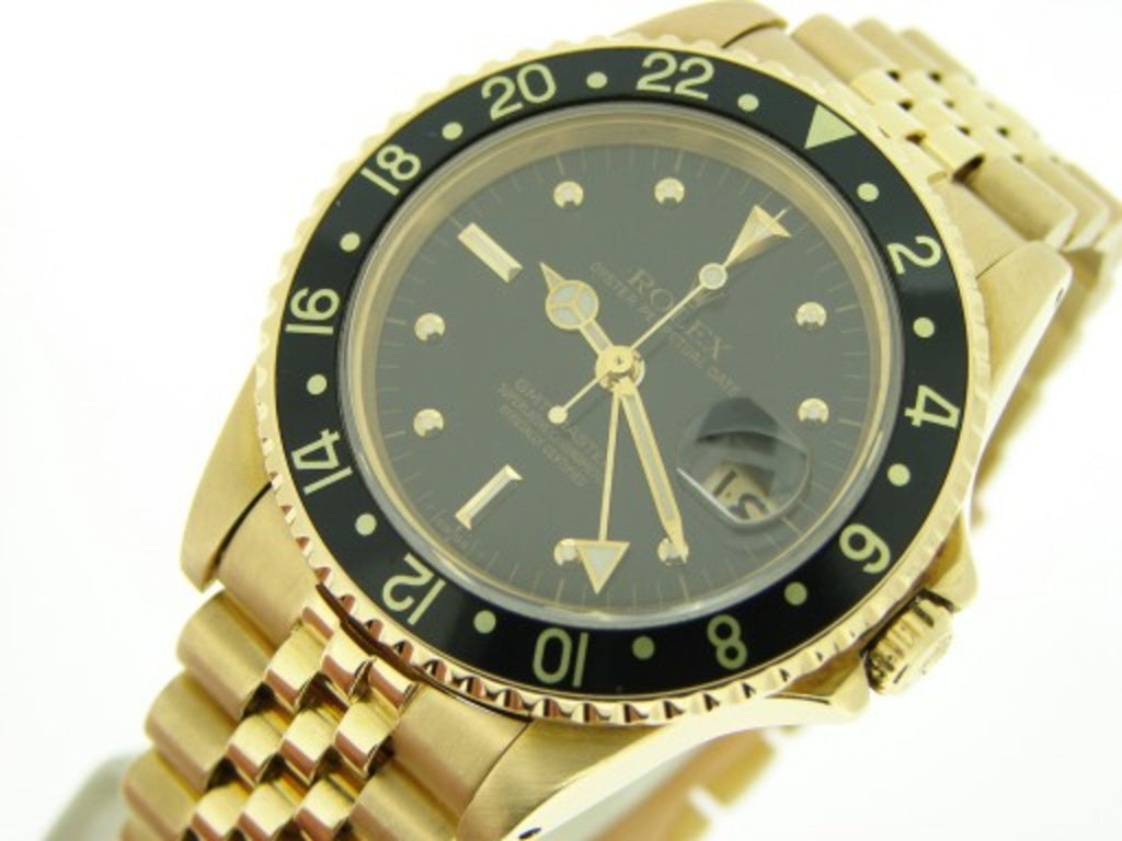 PRE OWNED MENS ROLEX YELLOW GOLD GMT-MASTER WITH A BLACK DIAL 16758