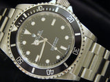 PRE OWNED MENS ROLEX STAINLESS STEEL SUBMARINER WITH A BLACK DIAL 14060M