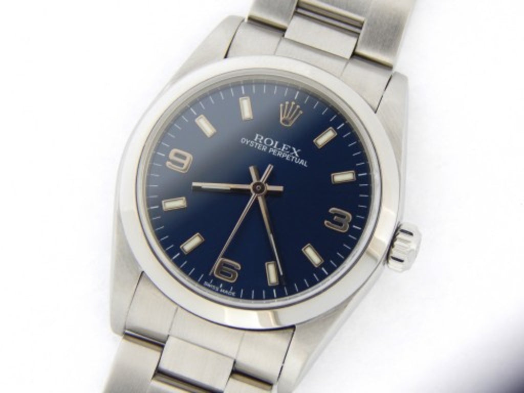 PRE OWNED MID SIZE ROLEX STAINLESS STEEL OYSTER PERPETUAL WITH A BLUE DIAL 77080