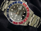 PRE OWNED MENS ROLEX STAINLESS STEEL GMT-MASTER PEPSI WITH A BLACK DIAL 16700