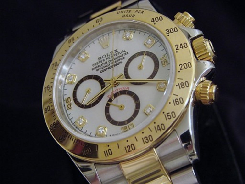 PRE OWNED MENS ROLEX TWO-TONE DAYTONA WITH A WHITE MOP DIAMOND DIAL 116523