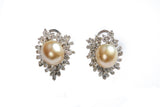 A pair of pearl and diamond ear clips