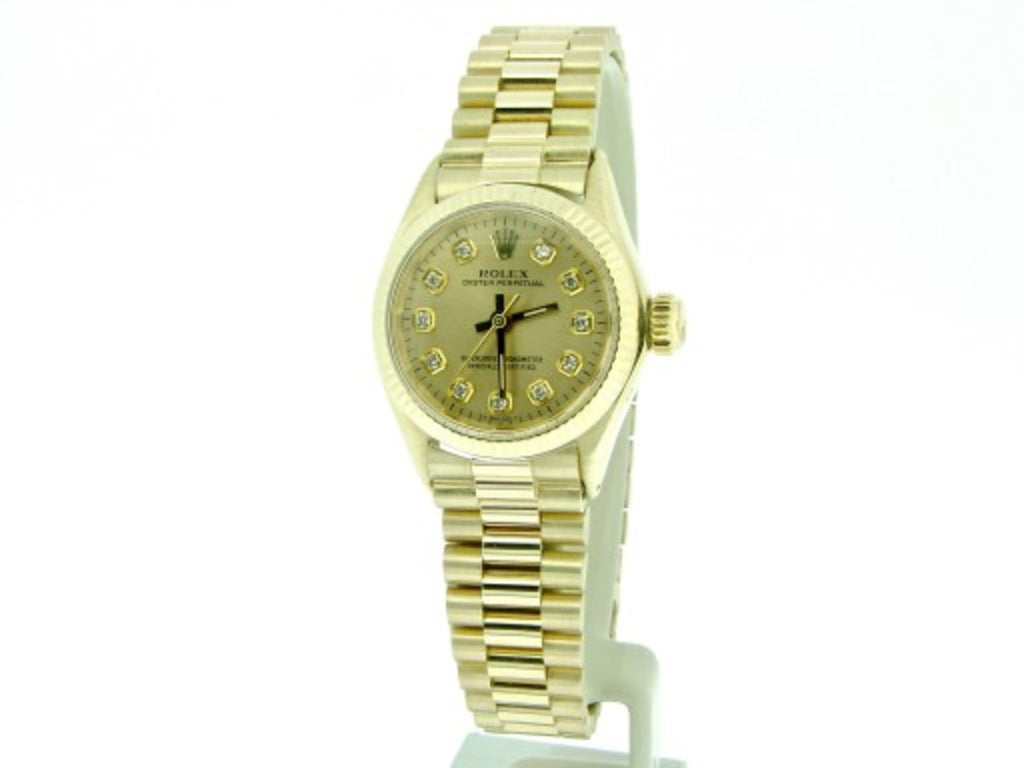 PRE OWNED LADIES ROLEX YELLOW GOLD OYSTER PERPETUAL WITH A CHAMPAGNE DIAMOND DIA
