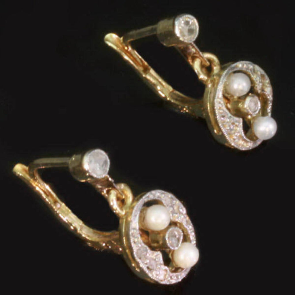 Two tone gold earrings with diamonds