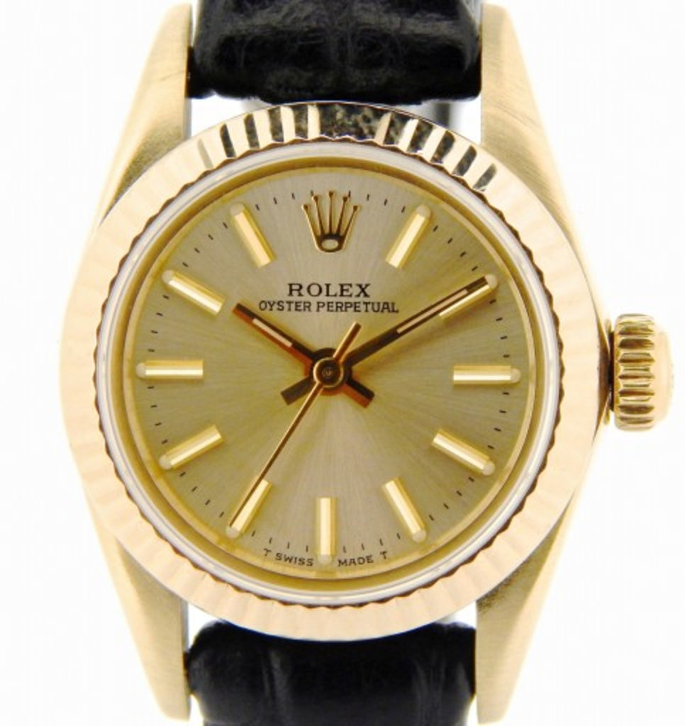 PRE OWNED LADIES ROLEX YELLOW GOLD OYSTER PERPETUAL WITH A CHAMPAGNE DIAL 67197