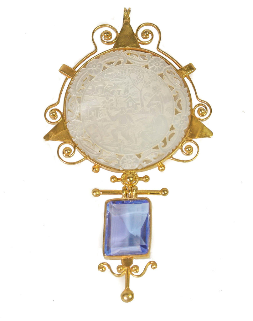 A mother-of-pearl gaming chip pendant