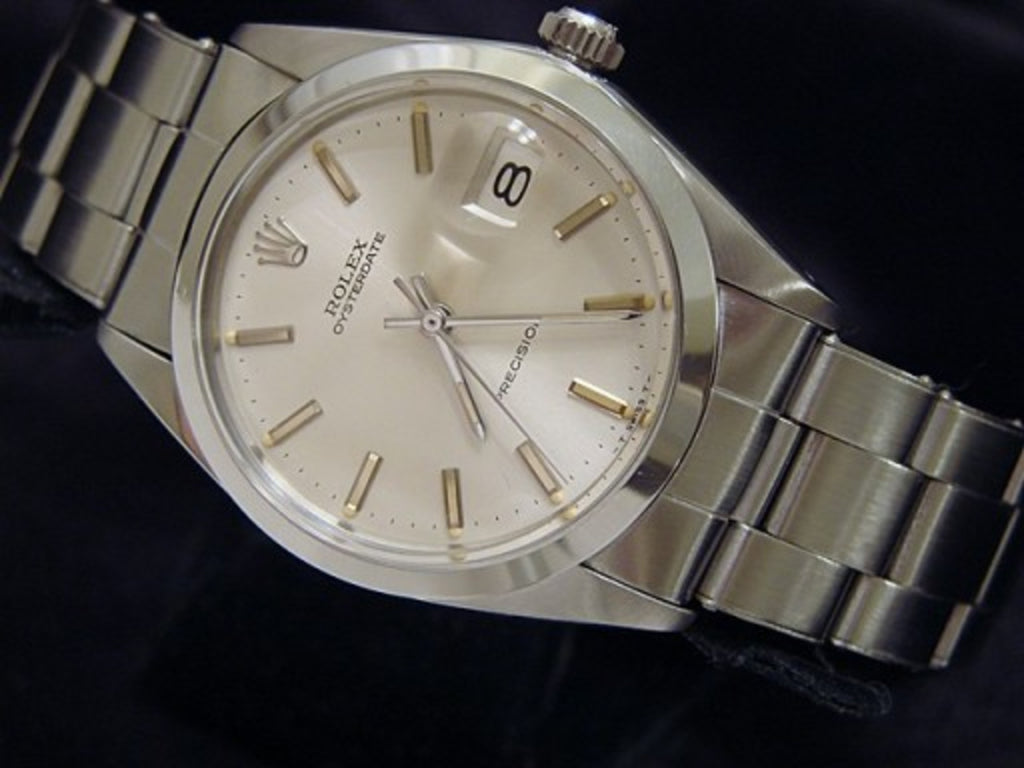 PRE OWNED MENS ROLEX STAINLESS STEEL OYSTERDATE WITH A SILVER DIAL 6694