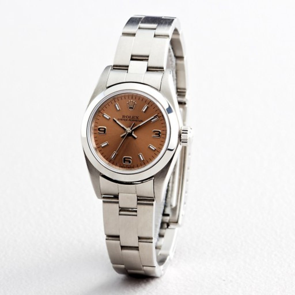 PRE OWNED LADIES ROLEX STAINLESS STEEL OYSTER PERPETUAL WITH A SALMON DIAL 76080