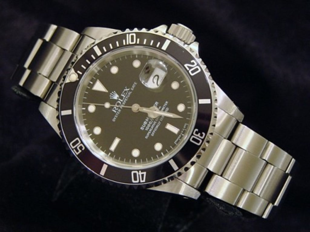 PRE OWNED MENS ROLEX STAINLESS STEEL SUBMARINER DATE WITH A BLACK DIAL 16800