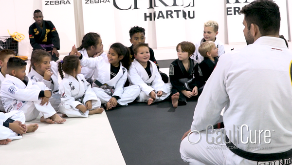 Marcus Buchecha Almeida chatting with young Brazilan Jiu Jitsu Athletes about Cauliflower ear and Cualicure
