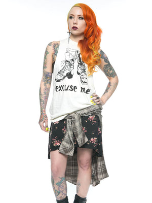Megan Massacre wearing the Excuse Me bone white muscle tee with black discharge boot graphic inspired by Daria