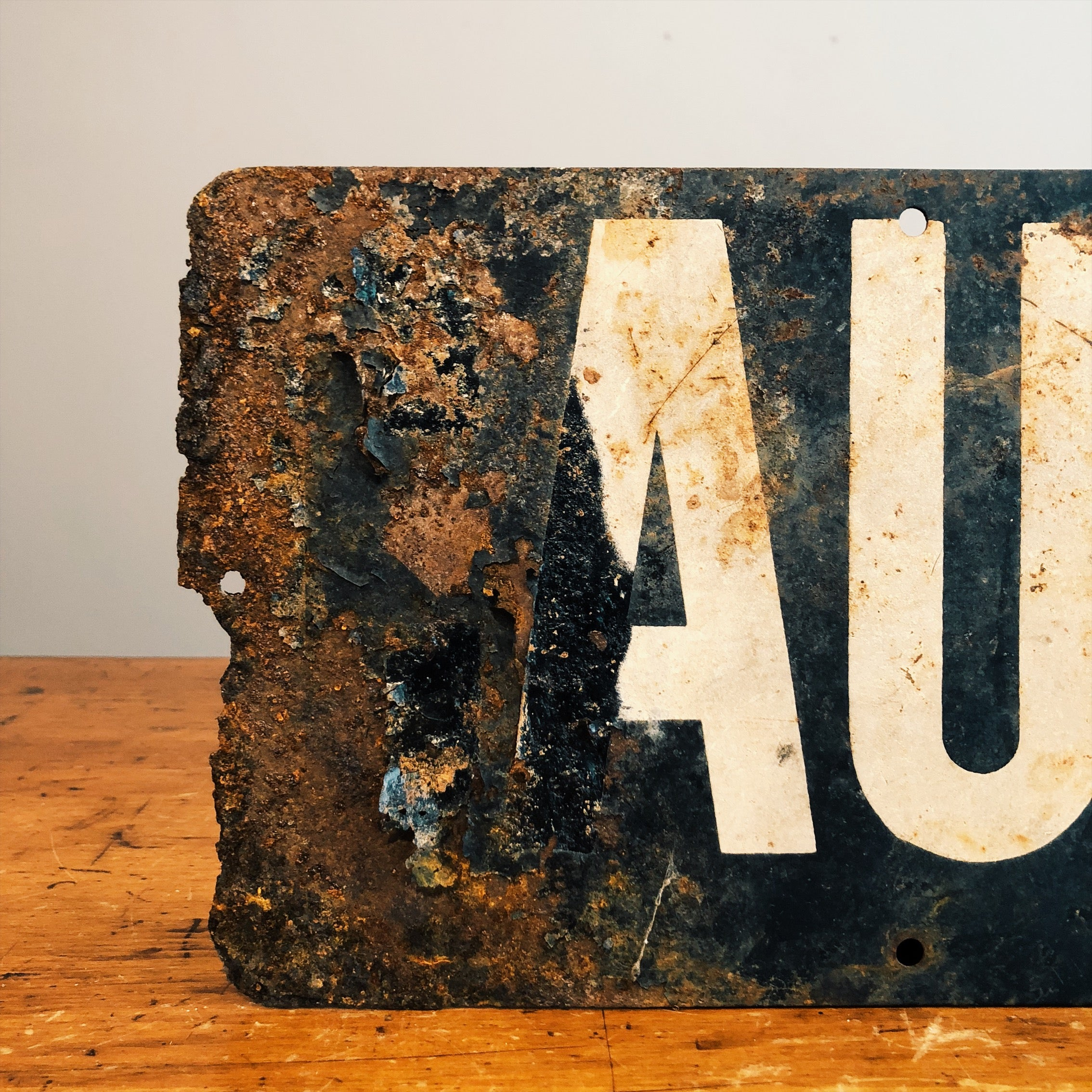 Front view of corrosion on Vintage Railroad Sign
