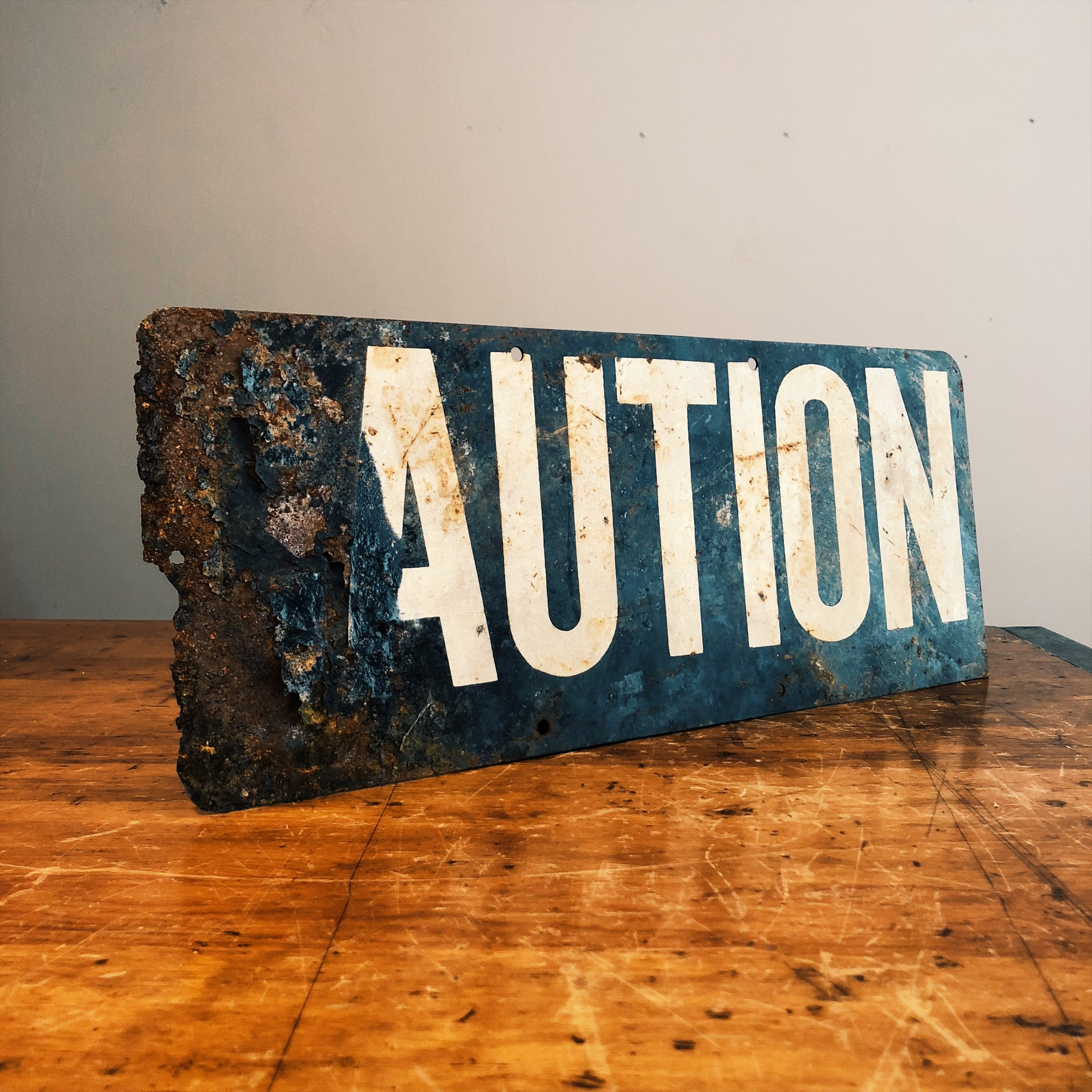 Corrosion on the Vintage Caution Railroad Sign