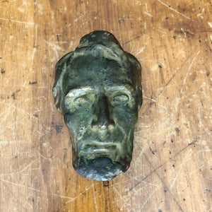 Natural light view of Antique Abraham Lincoln Bronze Resin Bust