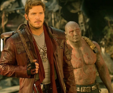 Chris Pratt in Guardian of the Galaxy Vol. 2 wearing custom pendants by LA designer, Dax Savage Jewelry.