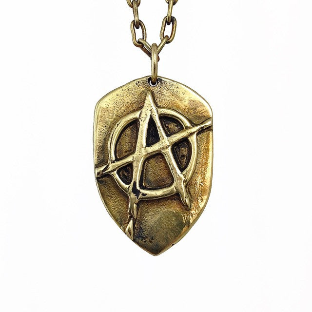Custom Iconic Anarchy Symbol Pendant in Rock Star Brass by Dax Savage Jewelry.