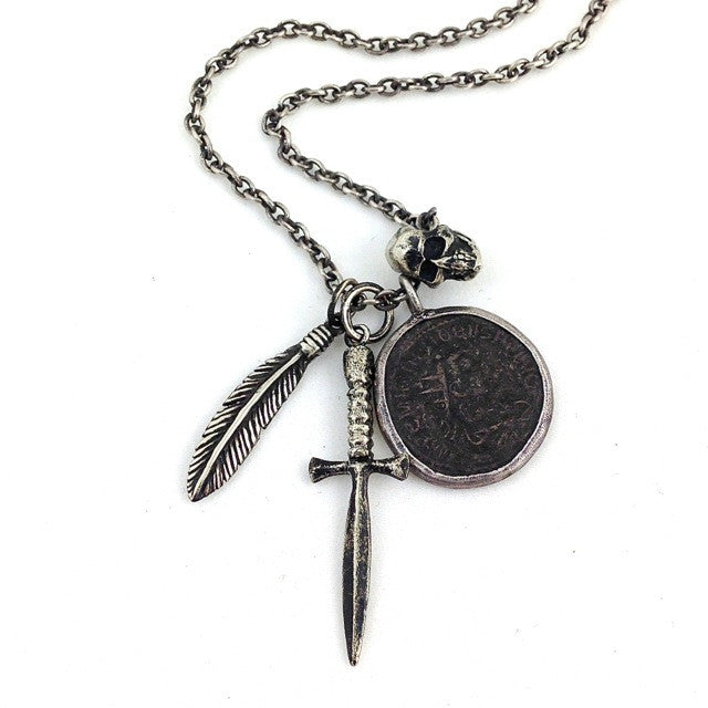 Custom One of a Kind Necklace with an Ancient Roman Numerian Coin and White Brass Dagger, Feather, and Skull by Dax Savage Jewelry.