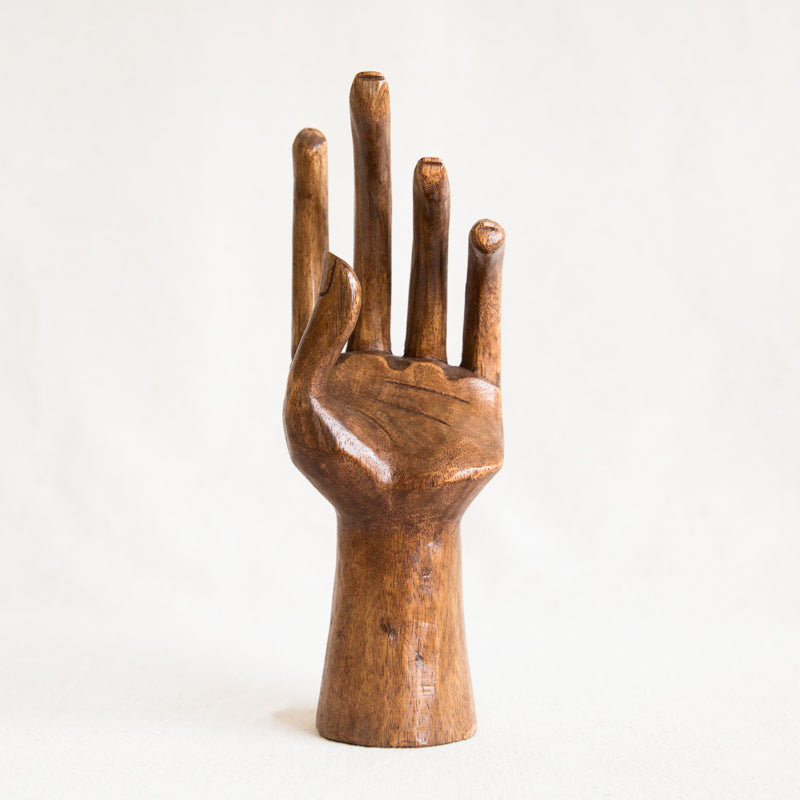 Vintage carved wood hand at general store