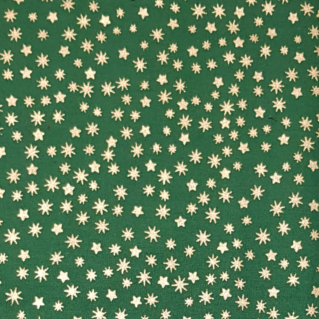 Christmas tiny star fabric green & gold 100 % Cotton sold per half metre 137cm wide