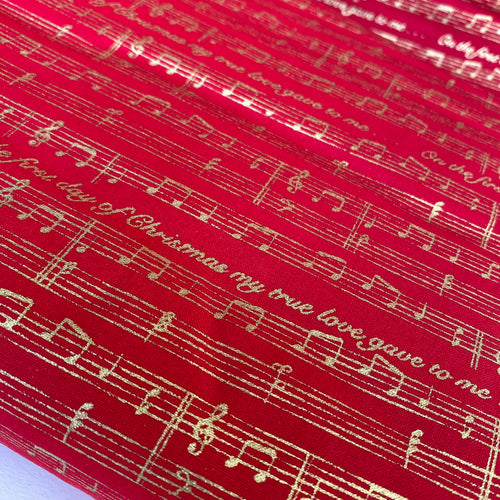 On the 1st day of Christmas Red & Gold Musical design 100% Cotton fabric, sold per 1/2 metre