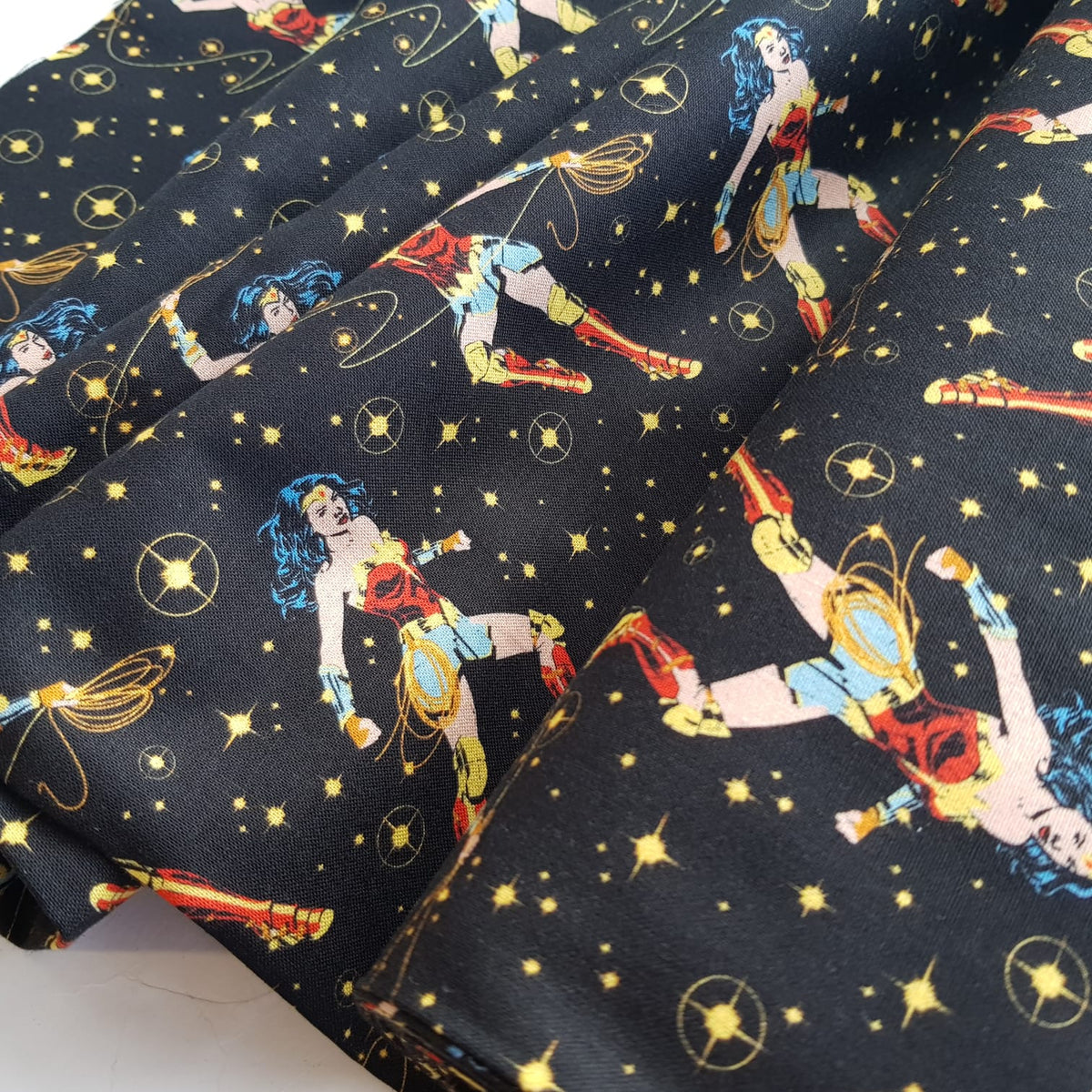 Wonder woman in action 100% premium cotton fabric, sold per half metre, 112cm wide