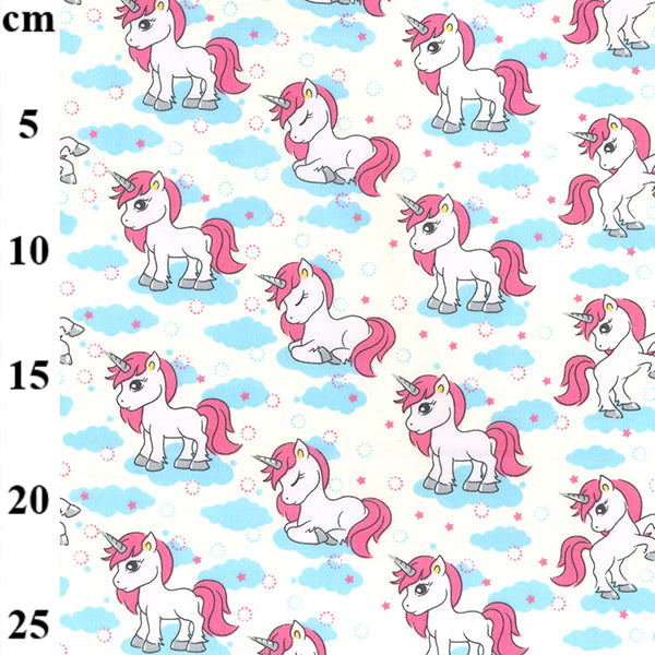 Ivory & blue Daydream unicorn design ivory 100% cotton poplin fabric sold per 1/2 metre