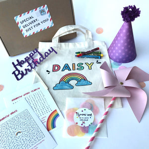 A box of personalised birthday craft and decorations