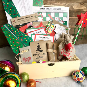 A Christmas box packed full of eco friendly crafts and games for 2 children