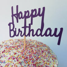 Load image into Gallery viewer, A birthday cake full of sprinkles with a Happy Birthday cake topper in the top.