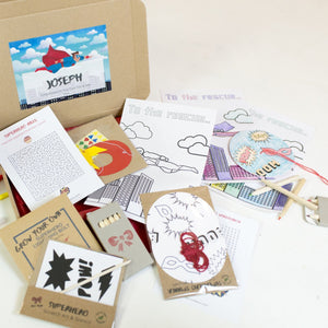 Superhero activity set with eco friendly crafts and games, perfect for a birthday party