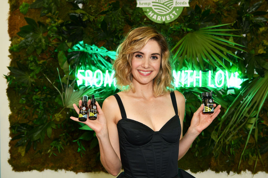 Allison Brie holding CBD products