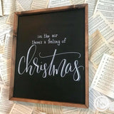 In the air theres a feeling of Christmas handmade sign