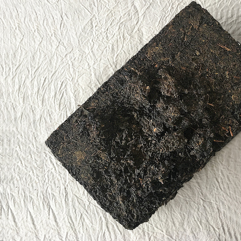 Mansa Tea | Onyx Black | Anhua Golden Flower Brick - high quality aged dark tea, a type of post-fermented tea from Hunan province, with aging potential of 40-60 years - image of dark tea brick