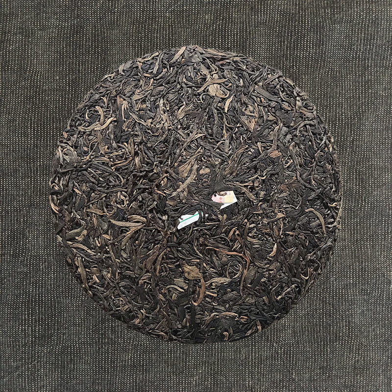 Mansa Tea | Amber Pu'er | Banzhang Raw Pu'er | high quality aged pu'er or pu-erh tea, a type of post-fermented tea from Yunnan province, with aging potential of 40-60 years - image of aged pu'er, aged pu-erh tea cake