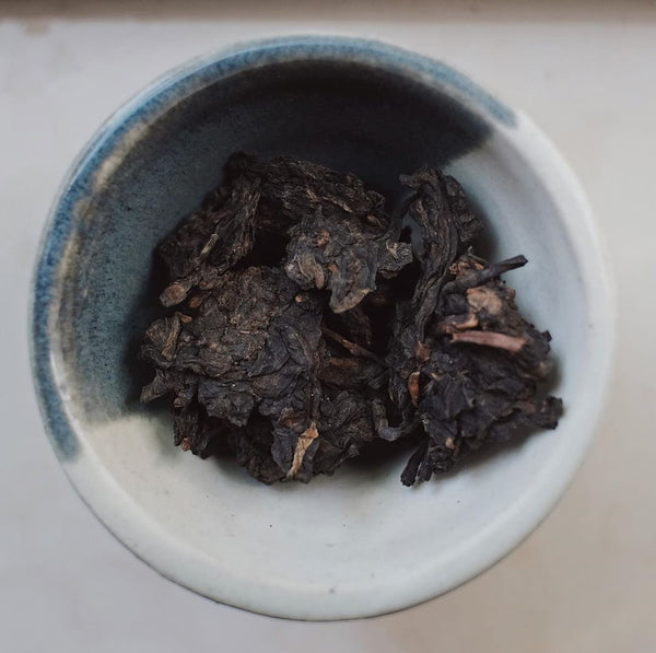 Loose tea cake of Ripe Pu-erh